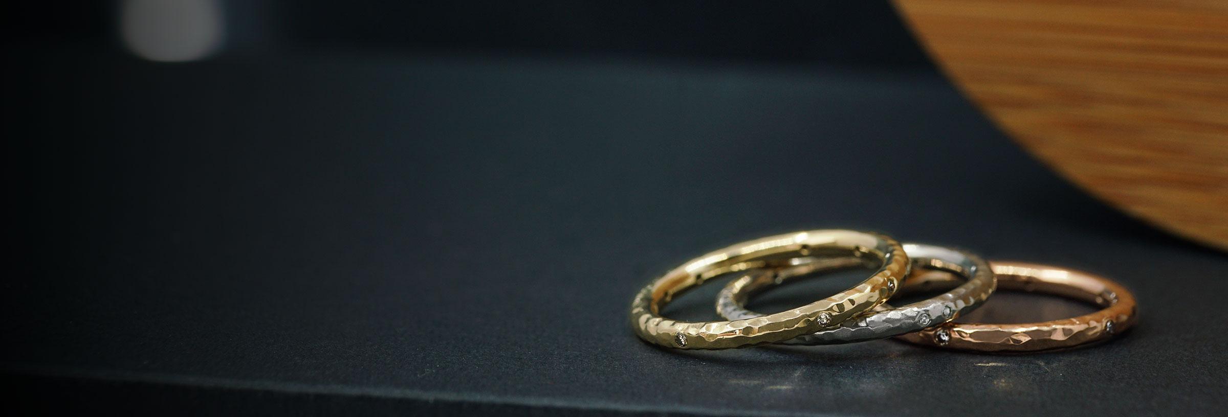 mixed-metal-diamond-set-stacking-rings