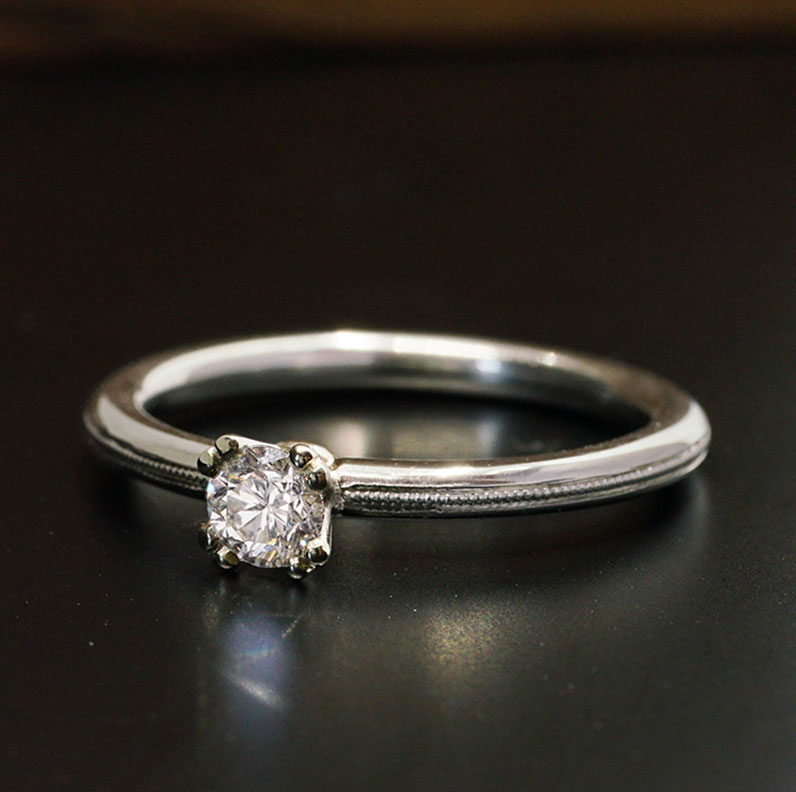 22180-delicate-white-gold-and-diamond-millegrained-engagement-ring_9.jpg