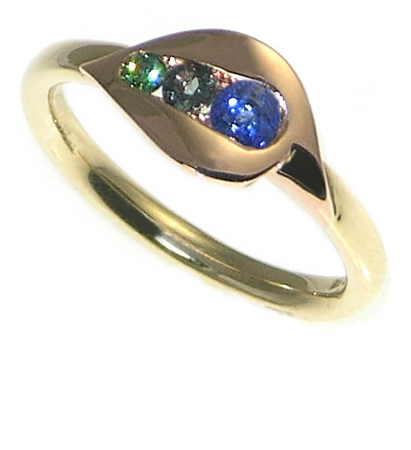 Peacock inspired engagement ring