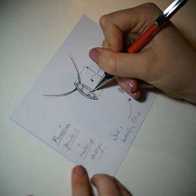 hand sketching a jewellery design